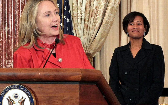 Hillary Clinton, when Secretary of State, flanked by Cheryl Mills, her chief of staff. Graham corresponded a lot with Mills about Haiti's politics. Mills forwarded some emails to Hillary.