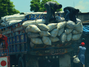 Charbon is put into large sacks then transported to Haiti's cities by trucks like this one, being unloaded in Pétionville. Credit: UN Photo