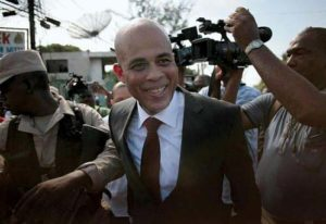 Jovenel's mentor, former president Michel Martelly (above), has long-standing ties to the Duvalier dictatorship. He played late-night shows for military friends through the late 1980s and early 1990s and belonged to Duvalier's dreaded Tonton Macoute militia in his youth.