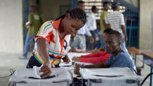 A Haitian voting station on Nov. 20, 2016. After the fall of the Duvalier dictatorship in 1986, Haiti's poor majority turned out en masse for general elections, but that cycle appears to be broken. Today, Haiti ranks among the lowest worldwide in terms of voter participation. Credit: Hector Retamal/AFP/Getty Images