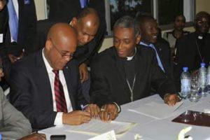 """Souriant, vous avez signé, cardinal Langlois, l'infâme ''Protocole d'accord'' à El Rancho. Il y a aussi un autre ''Protocole"""" à signer, mais avec la partie saine du pays, celui contre l'infamie et l'ignominie obscènes Ti Simonistes encouragées par l'actuel président Jovenel Moïse."""